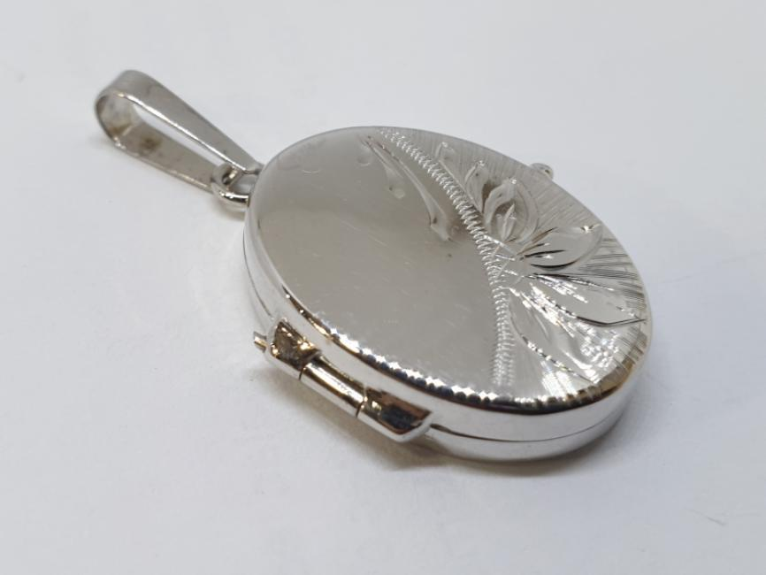 Medaljon od belog zlata za sliku