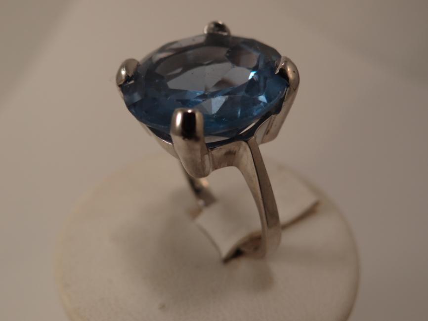 Silver ring with blue tophas